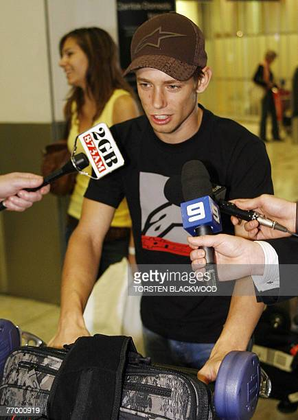 Newly crowned MotoGP World Champion Casey Stoner of Australia and his wife, Adriana , arrive at Sydney International Airport, 25 September 2007. The...