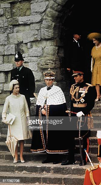Newly crowned Prince of Wales Great Britain's Prince Charles stands with his mother Queen Elizabeth II sister Princess Anne father Prince Philip and...