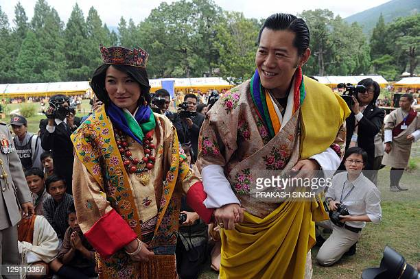 Newly crowned Queen of Bhutan Jetsun Pema and King of Bhutan Jigme Khesar Namgyel Wangchuck acknowledge the crowds after their marriage ceremony at...