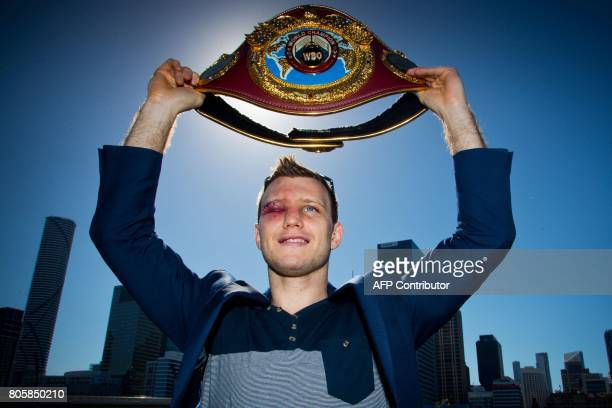 Newly crowned World Boxing Organization welterweight champion Jeff Horn of Australia poses for photographs with his belt during a press conference in...