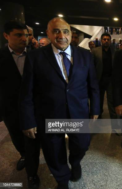 Newly designated Iraqi Prime Minister Adel Abdul Mahdi walks out of the Parliament in Baghdad on October 2 2018