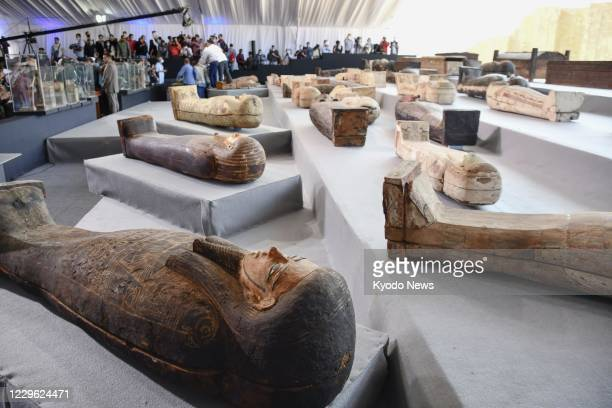 Newly discovered ancient coffins are on display for the media on Nov 14 in Saqqara near Cairo Egypt's Ministry of Tourism and Antiquities announced...