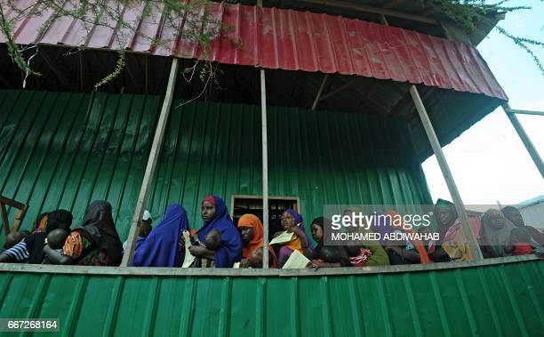 Newly displaced Somali women queue with their malnourished children as they try to receive medical treatment on outskirts of Mogadishu on April 11...