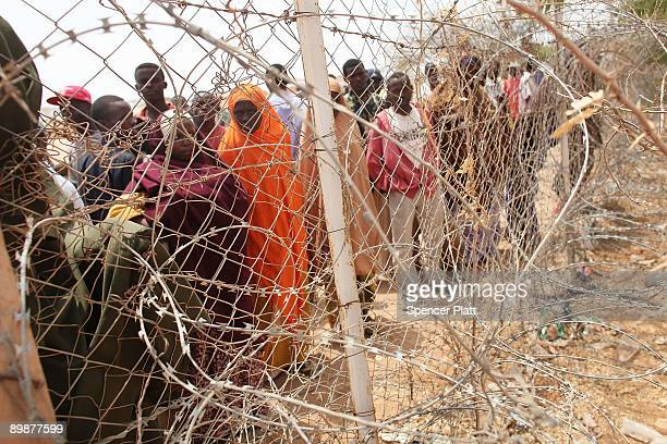 Newly displaced Somalis wait to get into a processing center in Dadaab, the world�s biggest refugee camp August 19, 2009 in Dadaab, Kenya. The Dadaab...