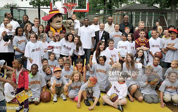 Newly drafted Kyrie Irving of the Cleveland Cavaliers helps unveil a newly remodeled basketball court with the help of new teammates Samardo Samuels...