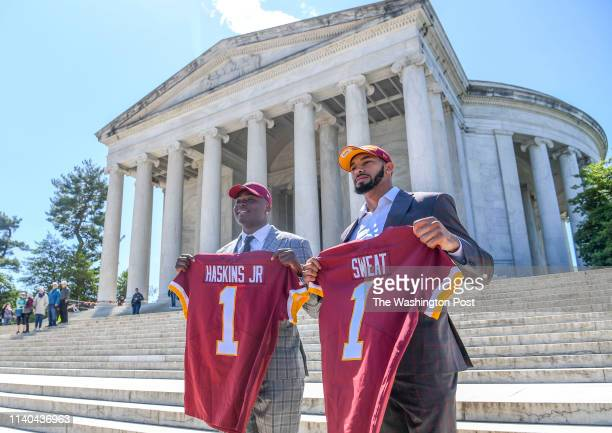 Newly drafted Washington Redskins Dwayne Haskins and Montez Sweat hold their jerseys at their introductory press conference held on the steps of the...