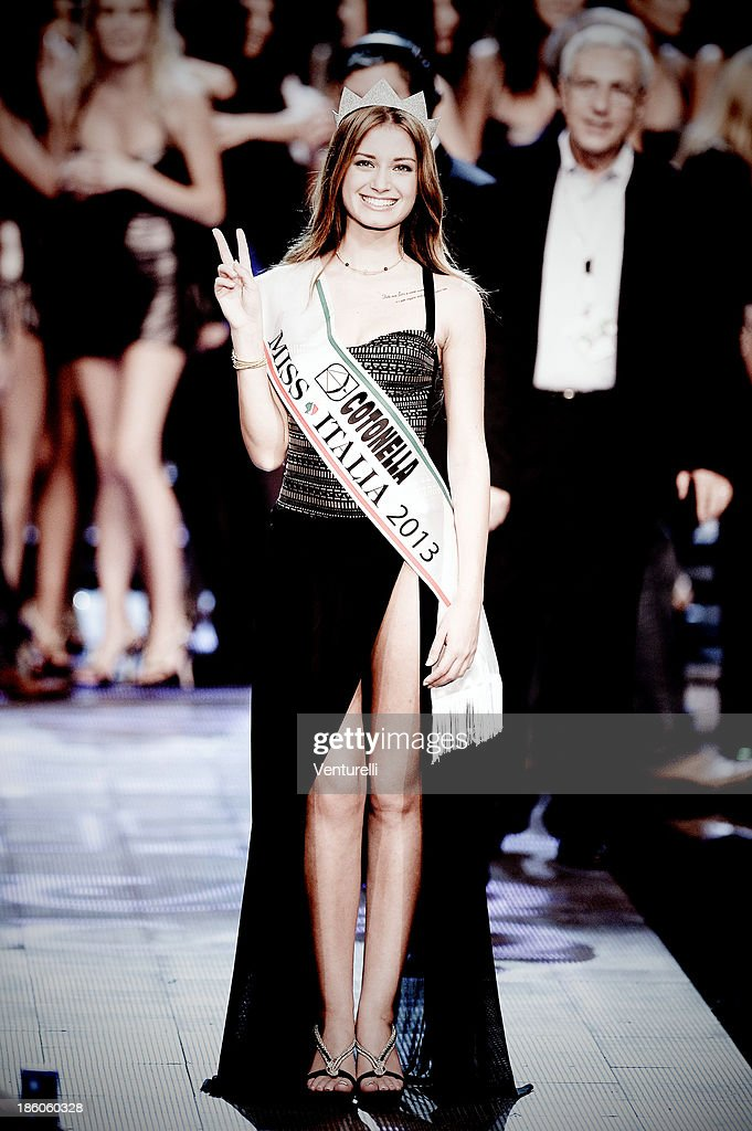 Newly elected 19-year-old Giulia Arena is crowned with the title of Miss Italia 2013 during the final of the beauty pageant contest 2013 at the Pala Arrex on October 27, 2013 in Jesolo, Italy.