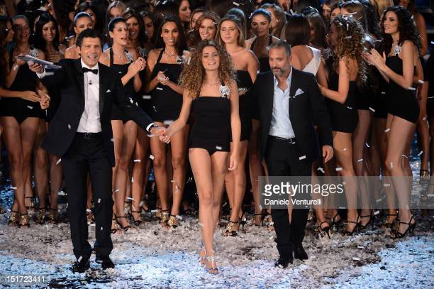 Newly elected 19yearold Giusy Buscemi is crowned with the title of Miss Italia 2012 Fabrizio Frizzi and Beppe Fiorello attend the final of the beauty...