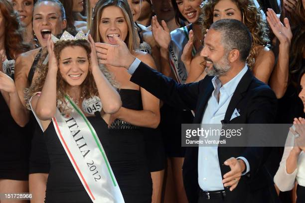 Newly elected 19yearold Giusy Buscemi is crowned with the title of Miss Italia 2012 and Beppe Fiorello attend the final of the beauty pageant contest...