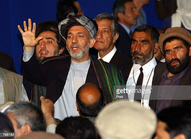 Newly elected Afghan President Hamid Karzai gestures to a crowd after his inauguration at the Loya Jirga grand assembly June 19, 2002 in Kabul,...