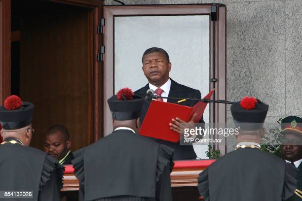 Newly elected Angolan President Joao Lourenco reads the oath of office during his swearing in ceremony as the new Angolan President on September 26...
