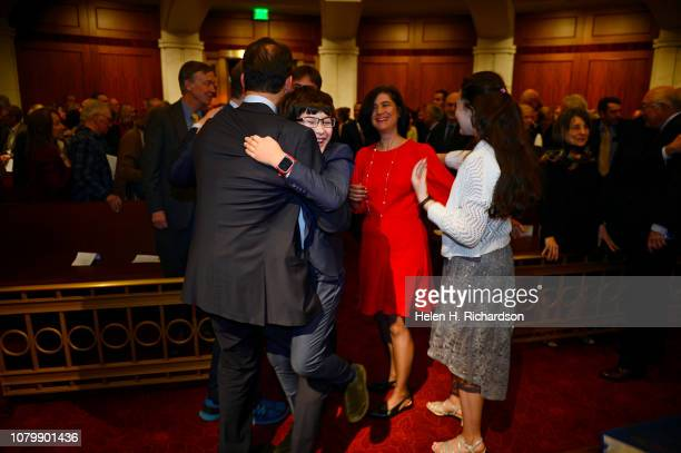 Newly elected Attorney General Phil Weiser gets a big hug from his son Sammy right after receiving the oath of office during his investiture ceremony...
