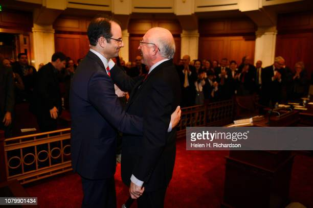Newly elected Attorney General Phil Weiser left gets a hug from former Colorado State Attorney General Ken Salazar right his after receiving the oath...