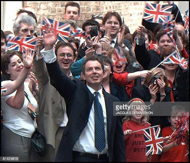 Newly elected British Prime Minister Tony Blair waves at supporters 02 May upon his arrival at No 10 Downing Street in London his new residence after...