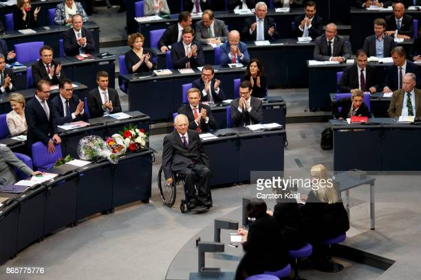 Newly elected Bundestag president Wolfgang Schaeuble moves to the President seat at the opening session of the new Bundestag on October 24 2017 in...
