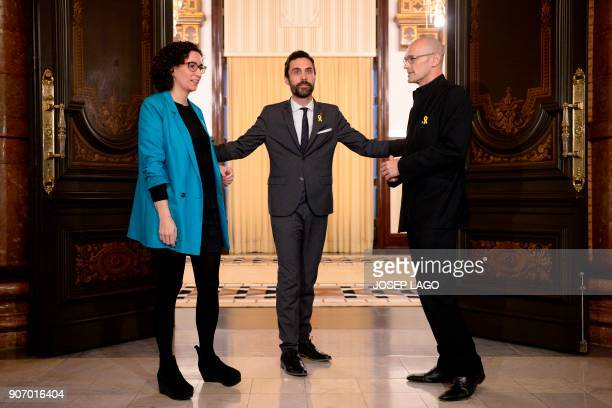 Newly elected Catalan parliament speaker Roger Torrent bids farewell to Republican Left of Catalonia secretary general Marta Rovira and Together for...