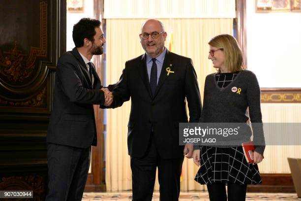 Newly elected Catalan parliament speaker Roger Torrent bids farewell to Junts per Catalunya's Elsa Artadi and Eduard Pujol after a meeting at the...