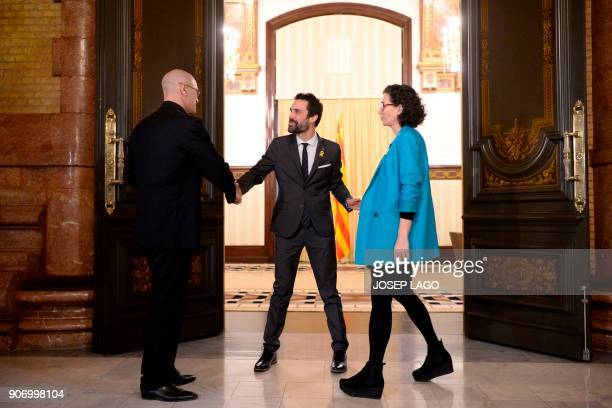Newly elected Catalan parliament speaker Roger Torrent greets Republican Left of Catalonia secretary general Marta Rovira and Together for Yes leader...