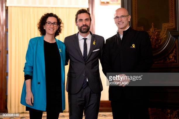 Newly elected Catalan parliament speaker Roger Torrent poses with Republican Left of Catalonia secretary general Marta Rovira and Together for Yes...