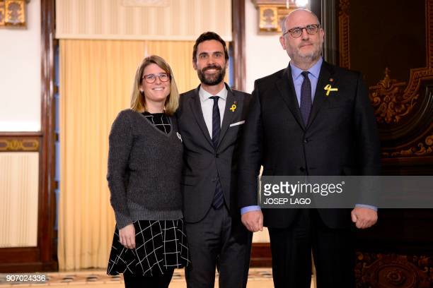Newly elected Catalan parliament speaker Roger Torrent poses with Junts per Catalunya's Elsa Artadi and Eduard Pujol during a meeting at the Catalan...