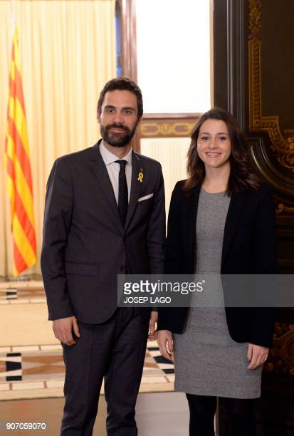 Newly elected Catalan parliament speaker Roger Torrent poses with Ines Arrimadas regional head of the antiindependence Cuidadanos party during a...