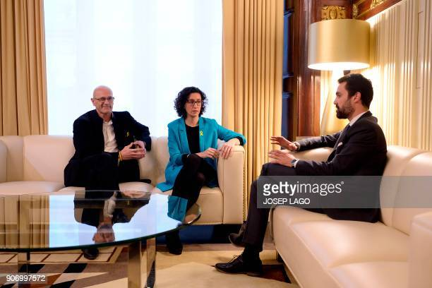 Newly elected Catalan parliament speaker Roger Torrent speaks with Republican Left of Catalonia secretary general Marta Rovira and Together for Yes...