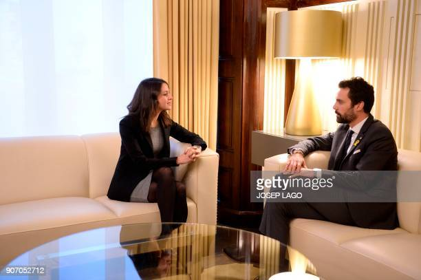 Newly elected Catalan parliament speaker Roger Torrent speaks with Ines Arrimadas regional head of the antiindependence Cuidadanos party during a...