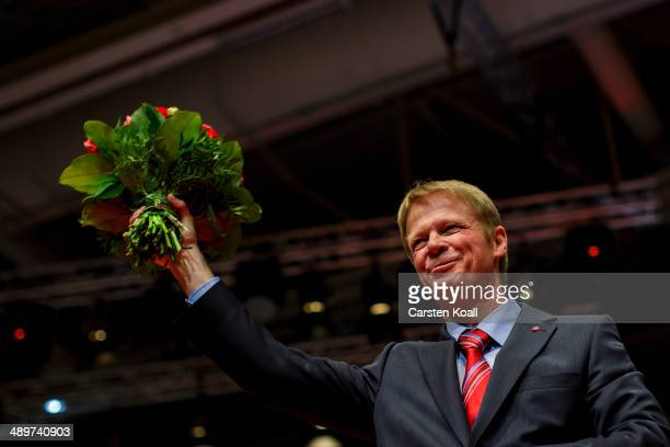 Newly elected chairman of the German Confederation of Trade Unions Reiner Hoffmann cheers after his is elected at the Federal Congress of the...