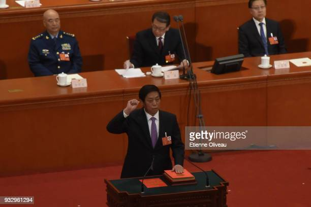 Newly elected Chairman of the National People's Congress Li Zhanshu swears under oath after being elected during the 5th plenary session of the first...