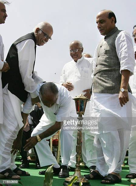 Newly elected Chief Minister of Karnataka State and state leader of the Bharatiya Janata Party , B S Yeddyurappa touches the feet of BJP senior...