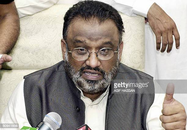 Newly elected Chief Minister of Pakistan's Sindh provincial assembly, Arbab Ghulam Rahim, gestures while giving a press conference in Karachi, 09...