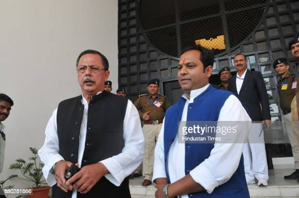 Newly elected Congress MLA from Chitrakoot coming to MP state Assembly with leader of opposition Ajay Singh on the first day of winter session on...