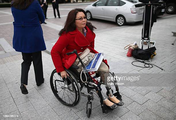 Newly elected Congressional freshmen Tammy Duckworth arrives to pose for a class picture with other new members of the 113th Congress on the steps of...