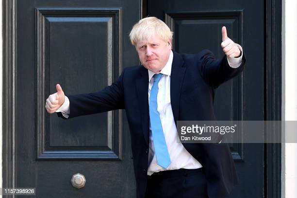 Newly elected Conservative party leader Boris Johnson poses outside the Conservative Leadership Headquarters on July 23, 2019 in London, England....