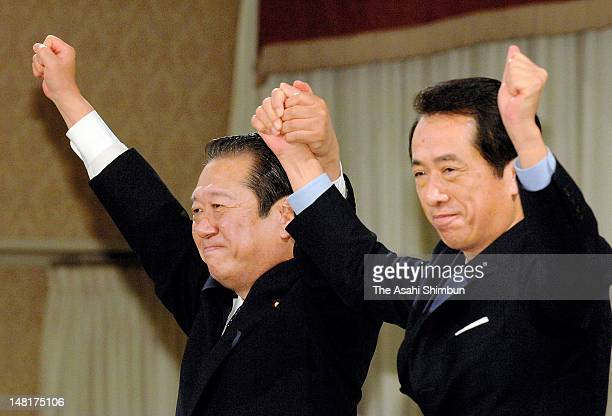Newly elected Democratic Party of Japan President Ichiro Ozawa and Naoto Kan raise their fists after the DPJ presidential election at a Tokyo hotel...