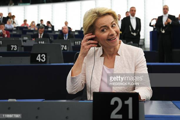 Newly elected European Commission President Ursula von der Leyen reacts after a vote on her election at the European Parliament in Strasbourg,...