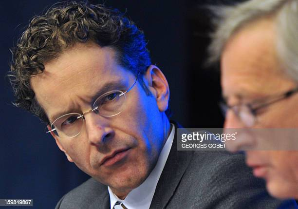 Newly elected Eurozone President and Dutch Finance Minister Jeroen Dijsselbloem looks at Luxembourg Prime Minister and former Eurogroup president...