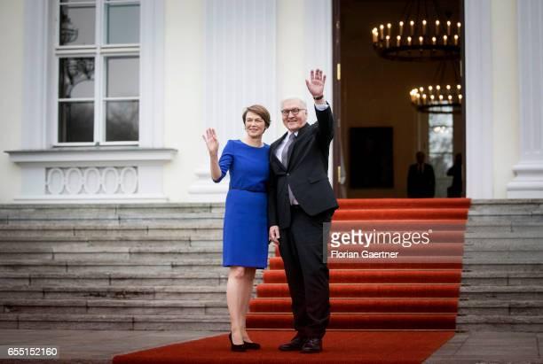Newly elected Federal President FrankWalter Steinmeier waves next to his partner Elke Buedenbender during the official handover at Bellevue Castle on...