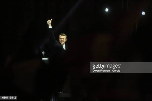 Newly elected French President Emmanuel Macron with his family holds a celebration rally outside the Louvre on May 7 2017 in Paris France