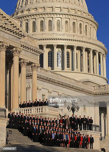 Newly elected freshman members of the upcoming 112th Congress pose for a class photo on the steps of the US Capitol on November 19 2010 in Washington...