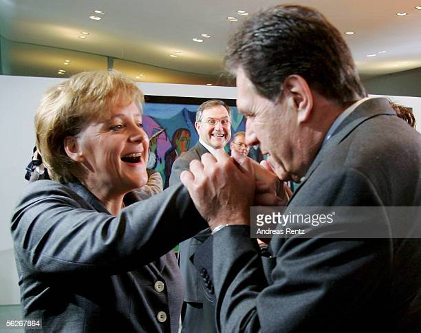 Newly elected German Chancellor Angela Merkel of the Christian Democrats receives kiss from Michael Glos, Economy Minister, at the beginning of the...