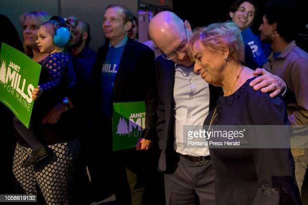 Newly elected governor of Maine Janet Mills leans on the shoulder of one of her campaign staff members before going out on stage for her victory...