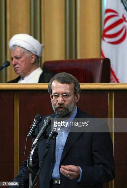 Newly elected head of Iran's Assembly of Experts Akbar Hashemi Rafsanjani listens to the head of Iran's Supreme National Security Council and top...