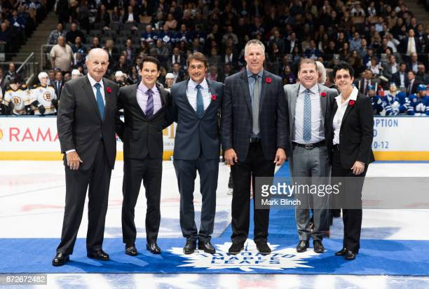 Newly elected Hockey Hall of Fame members Jeremy Jacobs Paul Kariya Teemu Selanne Dave Andreychuk Mark Recchi and Danielle Goyette stand at centre...