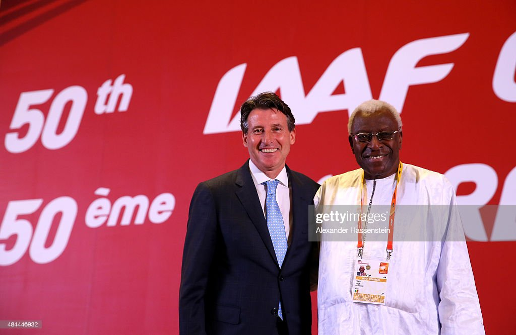Newly elected IAAF president Lord Sebastian Coe stands with outgoing president Lamine Diack during the 50th IAAF Congress at the China National Convention Centre, CNCC on August 19, 2015 in Beijing, China.