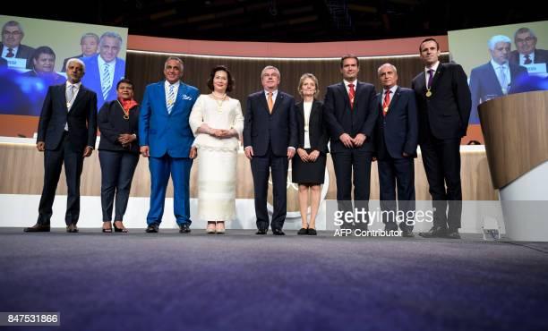 Newly elected International Olympic Committee members Sheikh Khalid Muhammad Al Zubair of Oman Baklai Temengil of Palau Luis Mejia Oviedo of...