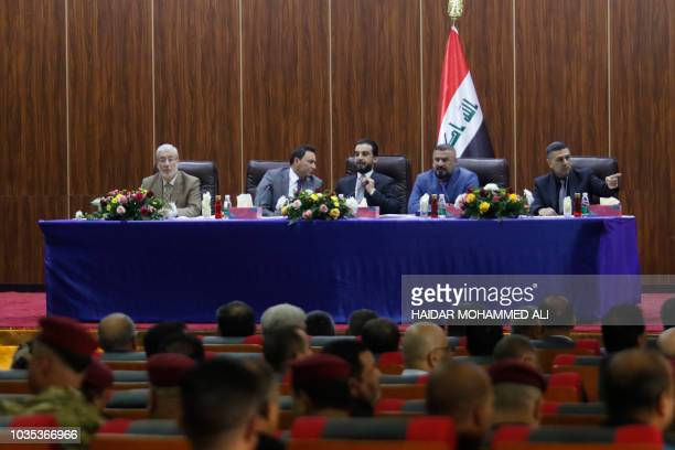 Newly elected Iraqi Parliament Speaker Mohamed alHalbusi heads a meeting at the local government headquarters during his visit to the southern city...