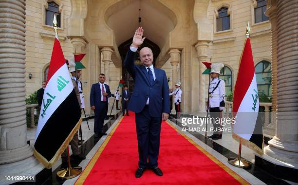 Newly elected Iraqi President Kurdish Barham Saleh greets the crowd during the handing over ceremony in Baghdad on October 3 2018 Moderate Kurdish...