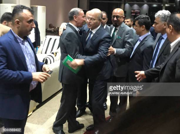Newly elected Iraqi President Kurdish Barham Saleh is greeted by MPs at the parliament in Baghdad on October 2 2018 The moderate Kurdish candidate...