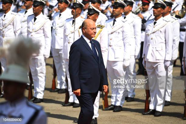 Newly elected Iraqi President Kurdish Barham Saleh reviews the honour guard during the handing over ceremony in Baghdad on October 3 2018 Moderate...